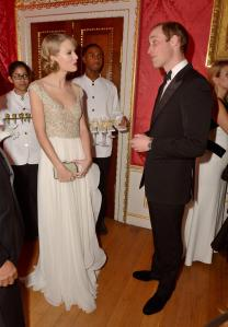 LONDON, ENGLAND - NOVEMBER 26: Prince William, Duke of Cambridge meets singer Taylor Swift at Kensington Palace for the Centrepoint Winter Whites Gala on November 26, 2013 in London, England. (Photo by Dominic Lipinski - WPA Pool/Getty Images)