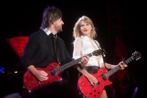 Taylor Swift plays along with Paul Sidoti at nib Stadium for the Red Tour. Photo: Matthew Tompsett