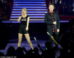 LONDON, ENGLAND - FEBRUARY 02: Seven-time Grammy winner Taylor Swift was joined on stage by Sam Smith as she continued the European leg of her blockbuster The RED Tour with the second of five sold-out shows at London's O2 Arena, playing to a capacity crowd of more than 15500 fans, on February 2, 2014 in London, England. (Photo by Sam Hussein/TAS/Getty Images for TAS)