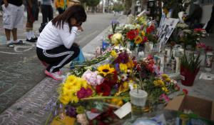 A memorial for Christopher Michael-Martinez, 20, a University of California, Santa Barbara, student who was killed outside a deli during a shooting rampage that left seven dead. (Photo: Lucy Nicholson / Reuters)